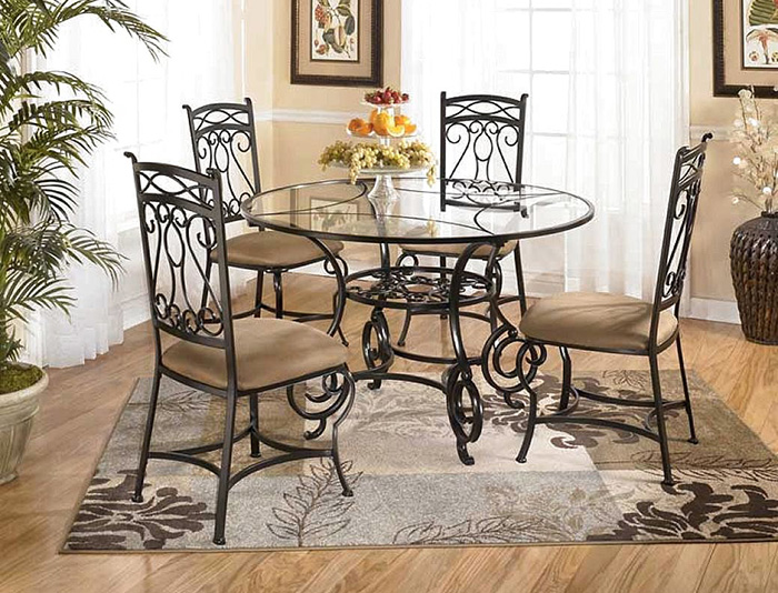 round wrought iron dining table and chairs